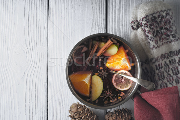 Stock photo: Pot with mulled whine on the white wooden table horizontal