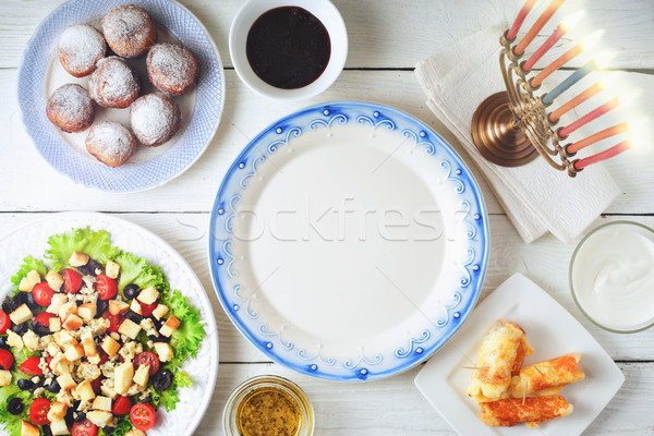 Traditional Hanukkah  dishes on the white wooden table top view Stock photo © Karpenkovdenis