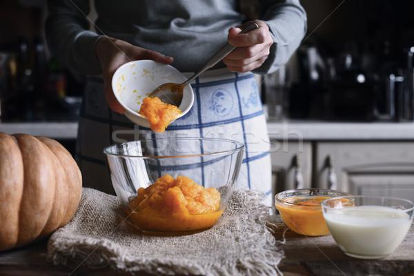 Putting pumpkin puree in the glass bowl horizontal Stock photo © Karpenkovdenis