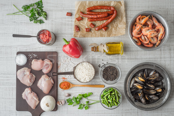 Stock photo: Ingredients for paella on the white  table horizontal