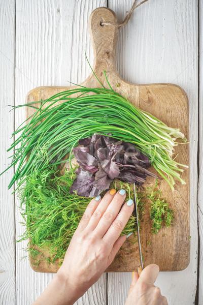 Woman cut fresh herbs on a cutting board Stock photo © Karpenkovdenis