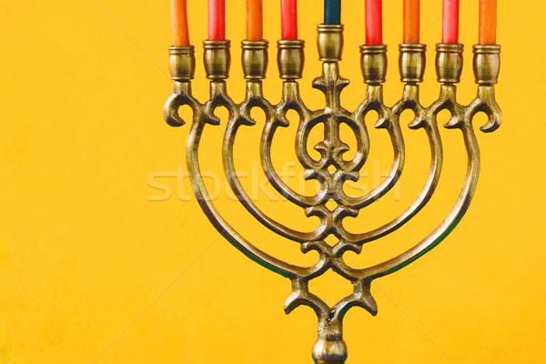 Hanukkah menorah with candles on the yellow background horizontal Stock photo © Karpenkovdenis