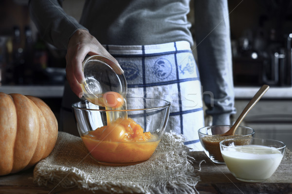 Adding eggs in the pumpkin puree in the glass bowl Stock photo © Karpenkovdenis