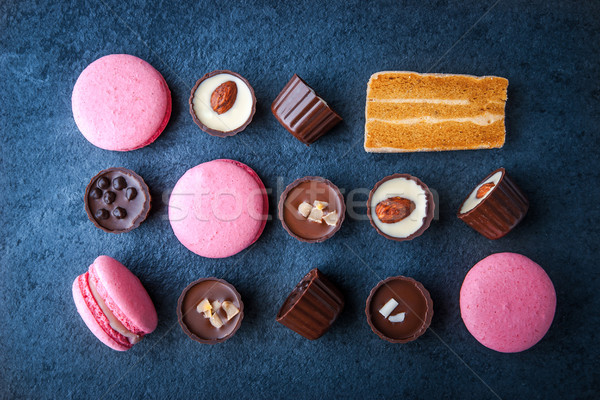 Composition from chocolates and pink macaroon Stock photo © Karpenkovdenis