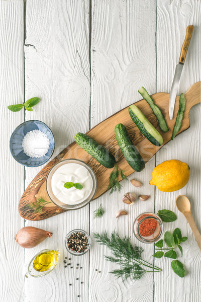 Ingredients for tzatziki preparation on the white  table  vertical Stock photo © Karpenkovdenis