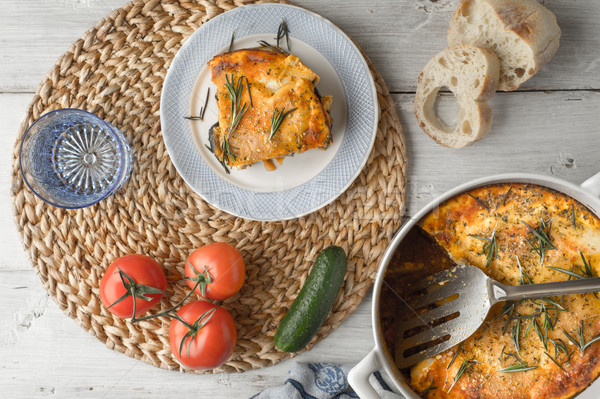 Eating moussaka in the white table with tableware and vegetables Stock photo © Karpenkovdenis