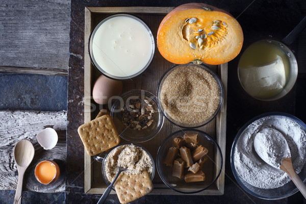 Ingredients for  pumpkin dump cake on the dark old background top view Stock photo © Karpenkovdenis