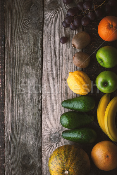 Assorted fruit at the right of the wooden table top view Stock photo © Karpenkovdenis