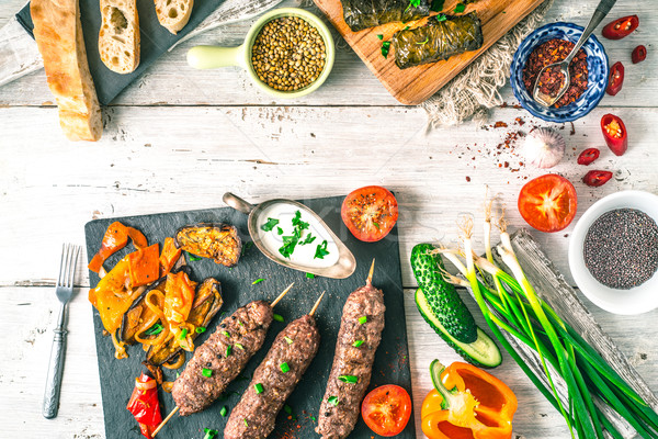 Kebabs with dolma, seasoning and vegetable. Concept Middle east , Asian and Caucasian cuisine horizo Stock photo © Karpenkovdenis