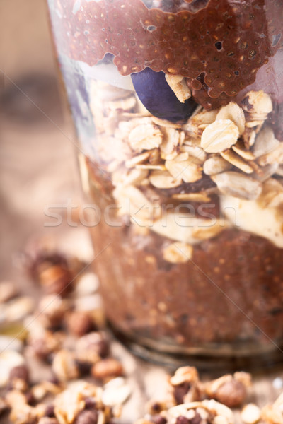 Chocolate chia pudding with oat flakes in the glass jar Stock photo © Karpenkovdenis