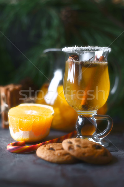 Citrus punch in the glass on the dark table vertical Stock photo © Karpenkovdenis