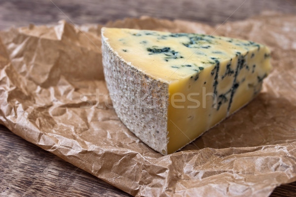 Stock photo: Cheese with a blue mold on the paper