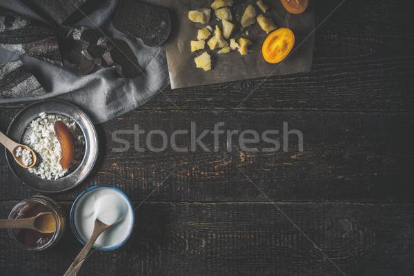 Different dairy products with bread on the wooden table top view Stock photo © Karpenkovdenis
