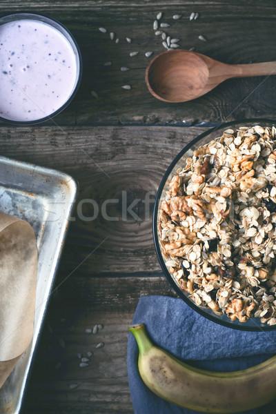 Granola üveg tál különböző kellékek fa asztal Stock fotó © Karpenkovdenis