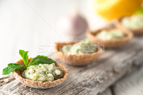 Crisp bread with tzatziki on the white wooden board close-up Stock photo © Karpenkovdenis