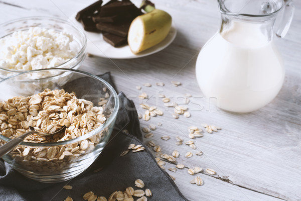 Oat flakes in a glass bowl on the wooden table Stock photo © Karpenkovdenis