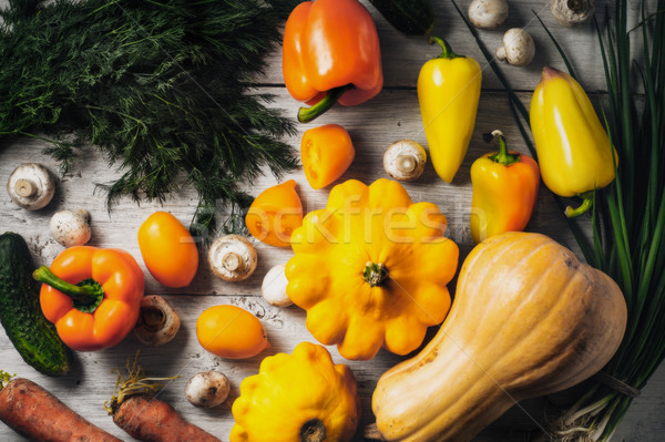 Yellow and green vegetables on the white wooden table horizontal Stock photo © Karpenkovdenis