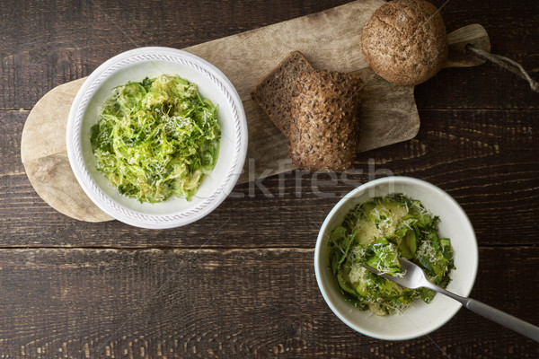 Zucchini noodles with cheese and bread on the wooden table top view Stock photo © Karpenkovdenis