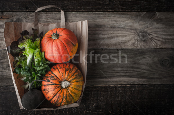 Stock photo: Pumpkins , turnip and greens inside a paper bag horizontal