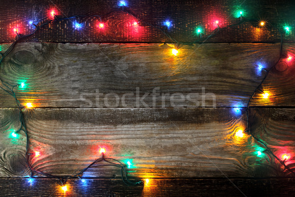 Frame of the colorful festoon on the wooden board Stock photo © Karpenkovdenis