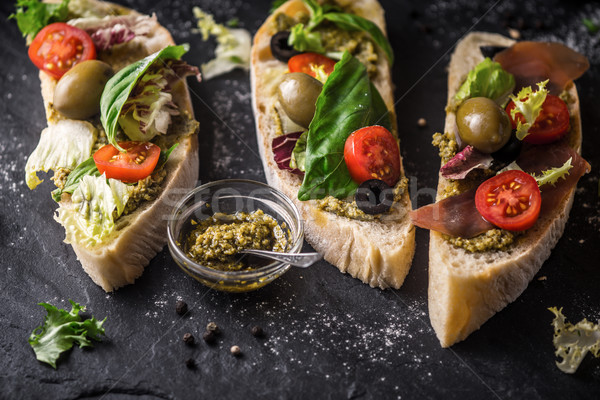 Ciabatta with olives , tomatoes and basil on the black stone table Stock photo © Karpenkovdenis
