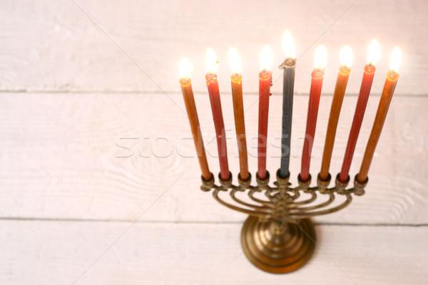 Stock photo: Hanukkah menorah with burning candles on the white wooden table horizontal