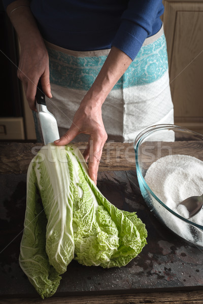 Woman cut Chinese cabbage to cook kimchi on slate Stock photo © Karpenkovdenis