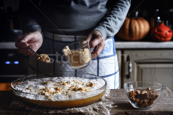 Adding grated crackers in the dough for pumpkin dump cake Stock photo © Karpenkovdenis