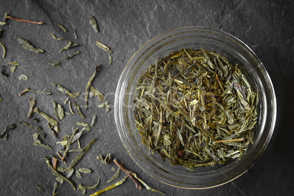 Tea leaves on the glass jar on the  dark stone background top view Stock photo © Karpenkovdenis