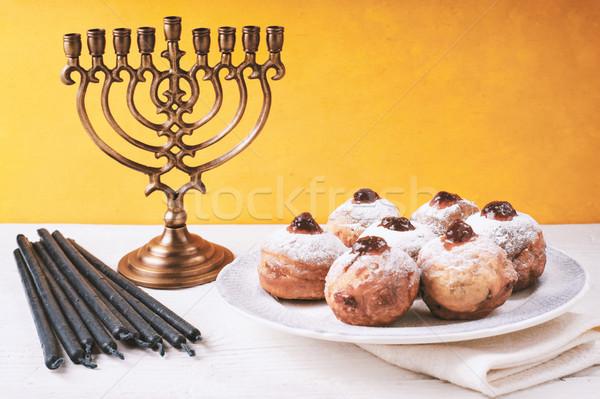 Hanukkah still life with menorah and sufganiot Stock photo © Karpenkovdenis