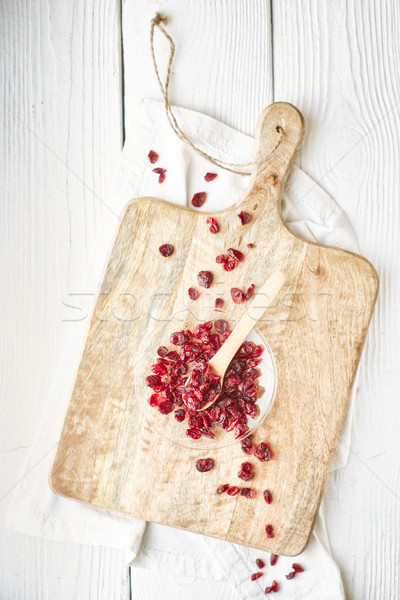 Dried cranberries in the glass bowl on the  white wooden table top view Stock photo © Karpenkovdenis