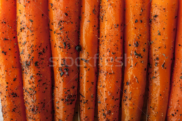 Baked carrots with black pepper and herbs  close-up background h Stock photo © Karpenkovdenis