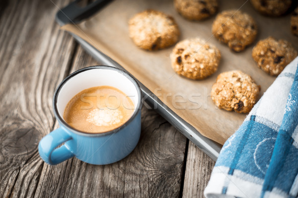Oatmeal cookies and coffee cup on a wooden table Stock photo © Karpenkovdenis