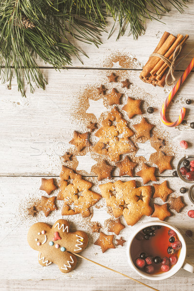 Christmas tree made by cookies  and cinnamon on the white wooden table  with berry tea vertical Stock photo © Karpenkovdenis
