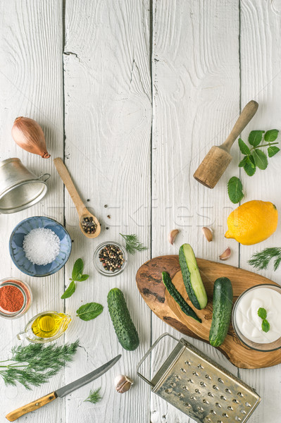 Ingredients for tzatziki preparation on the white  wooden table Stock photo © Karpenkovdenis