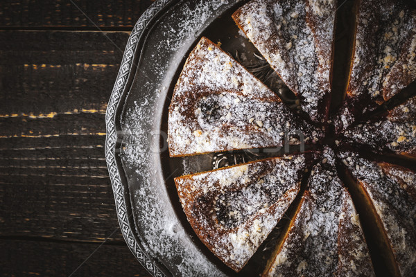 Sliced cake with icing sugar and jam on the vintage metal plate  Stock photo © Karpenkovdenis