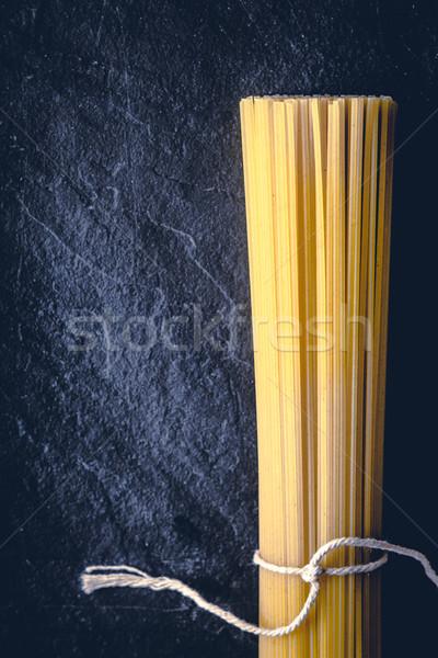 Greggio spaghetti nero pietra verticale sfondo Foto d'archivio © Karpenkovdenis