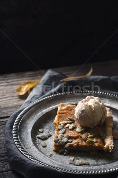 Slice of pumpkin pie with ice cream on the metal plate vertical Stock photo © Karpenkovdenis
