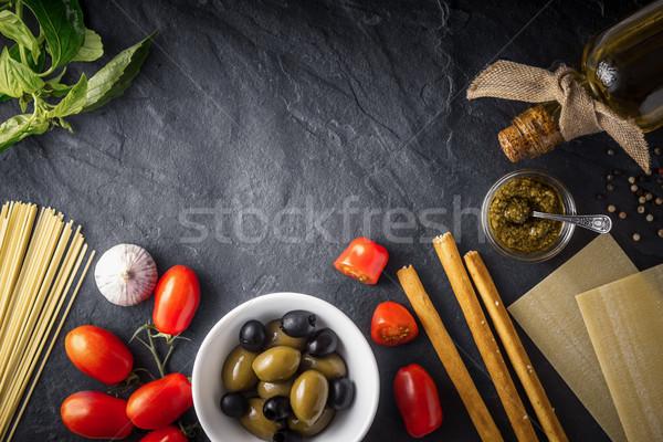 Italian food  mix on the black stone table top view Stock photo © Karpenkovdenis