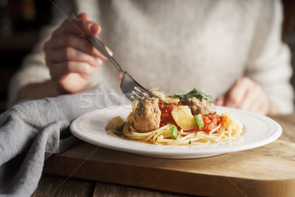 Woman eating spaghetti with meatballs Stock photo © Karpenkovdenis