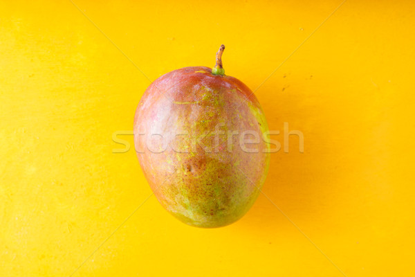 Mango on a yellow table Stock photo © Karpenkovdenis