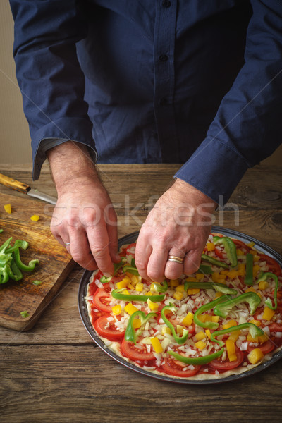Man makes homemade pizza in the kitchen Stock photo © Karpenkovdenis