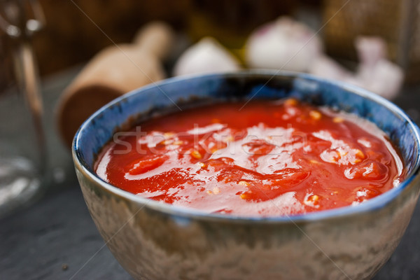 Pureed tomatoes in a ceramic dish on a table Stock photo © Karpenkovdenis