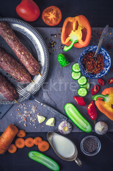 Kebabs with seasoning and vegetable. Concept Middle east , Asian and Caucasian cuisine vertical Stock photo © Karpenkovdenis