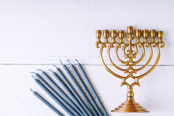 Hanukkah menorah and candles on the white wooden table top view Stock photo © Karpenkovdenis