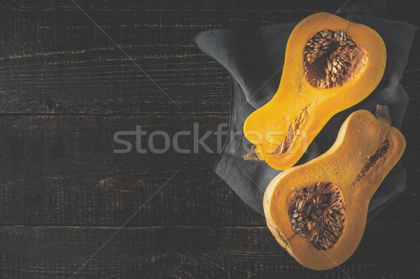 Pumpkin halves on the old wooden table horizontal Stock photo © Karpenkovdenis