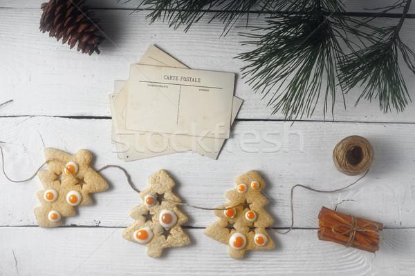 Grinalda natal bolinhos cartão postal branco Foto stock © Karpenkovdenis