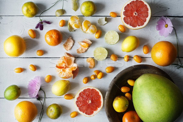 Citrus mix on the white wooden background  top view Stock photo © Karpenkovdenis