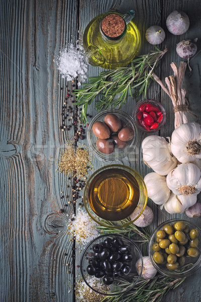 Olives with seasoning mix on the blue wooden table vertical Stock photo © Karpenkovdenis