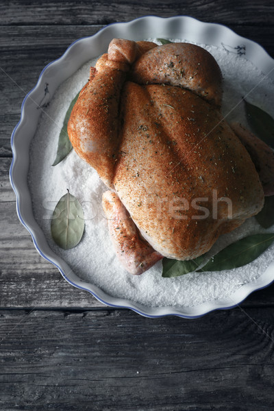 Raw Thanksgiving day turkey with spices on the baking dish with salt and bay leaf vertical Stock photo © Karpenkovdenis